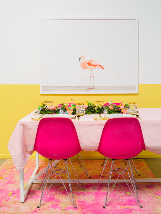 a pink & yellow bird-themed table setting